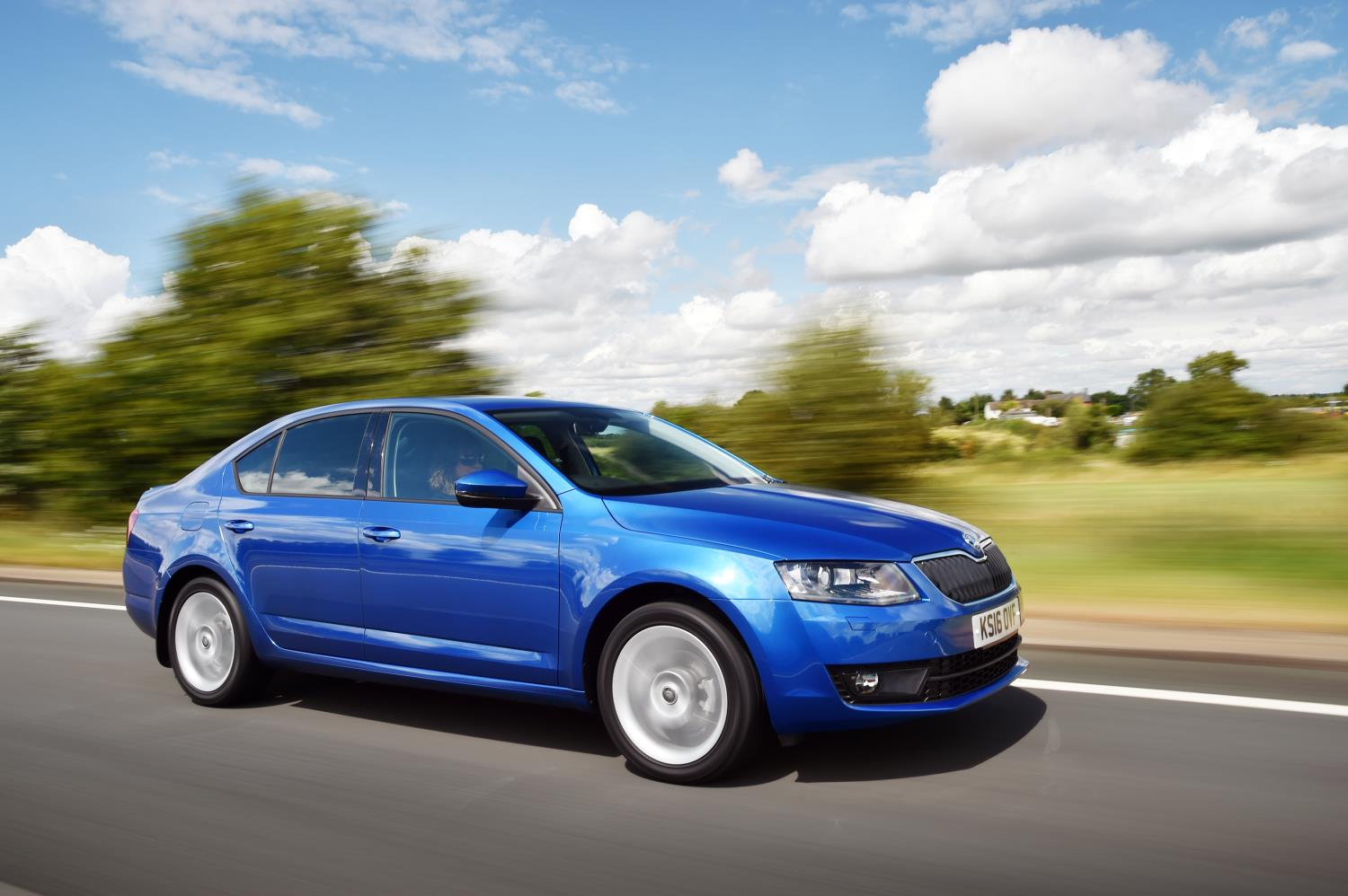 Skoda Octavia side view on road in blue