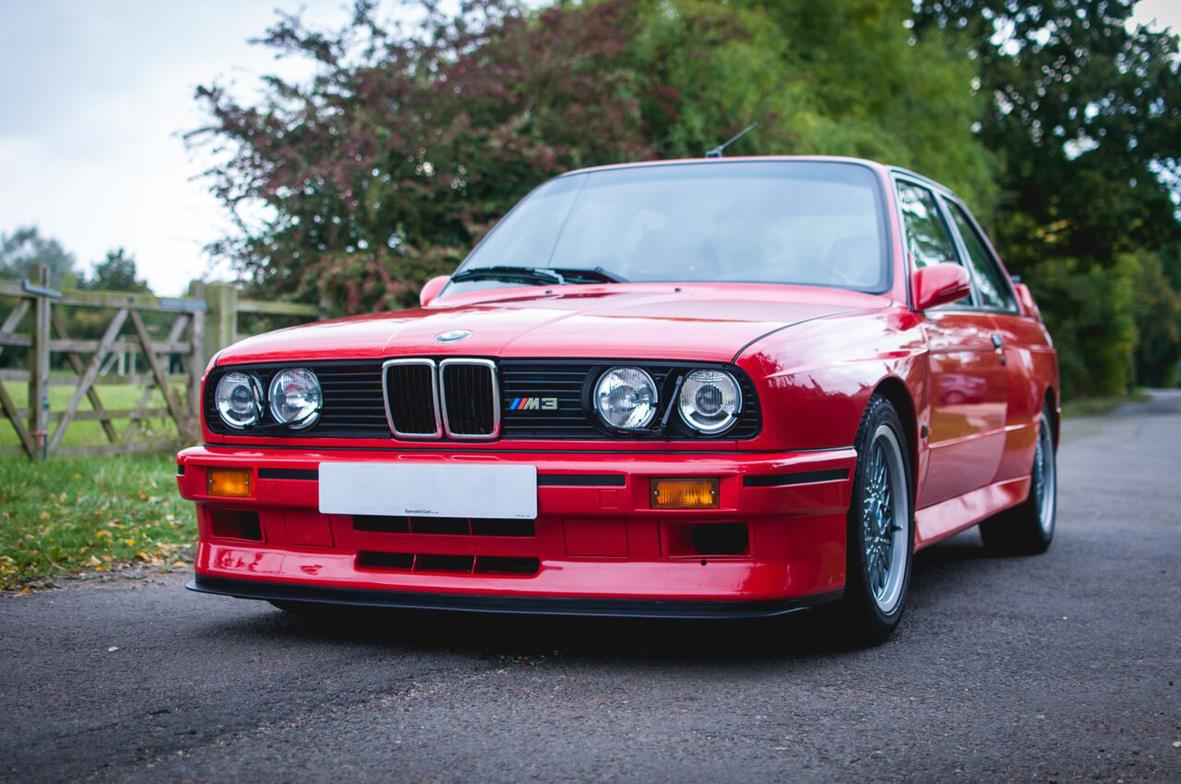 BMW E30 M3 front view in red
