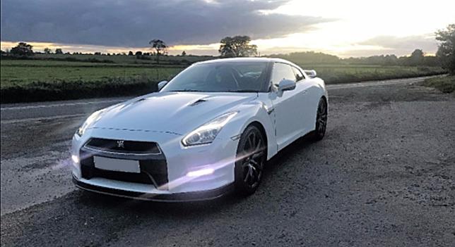 Nissan Skyline GTR white at dusk
