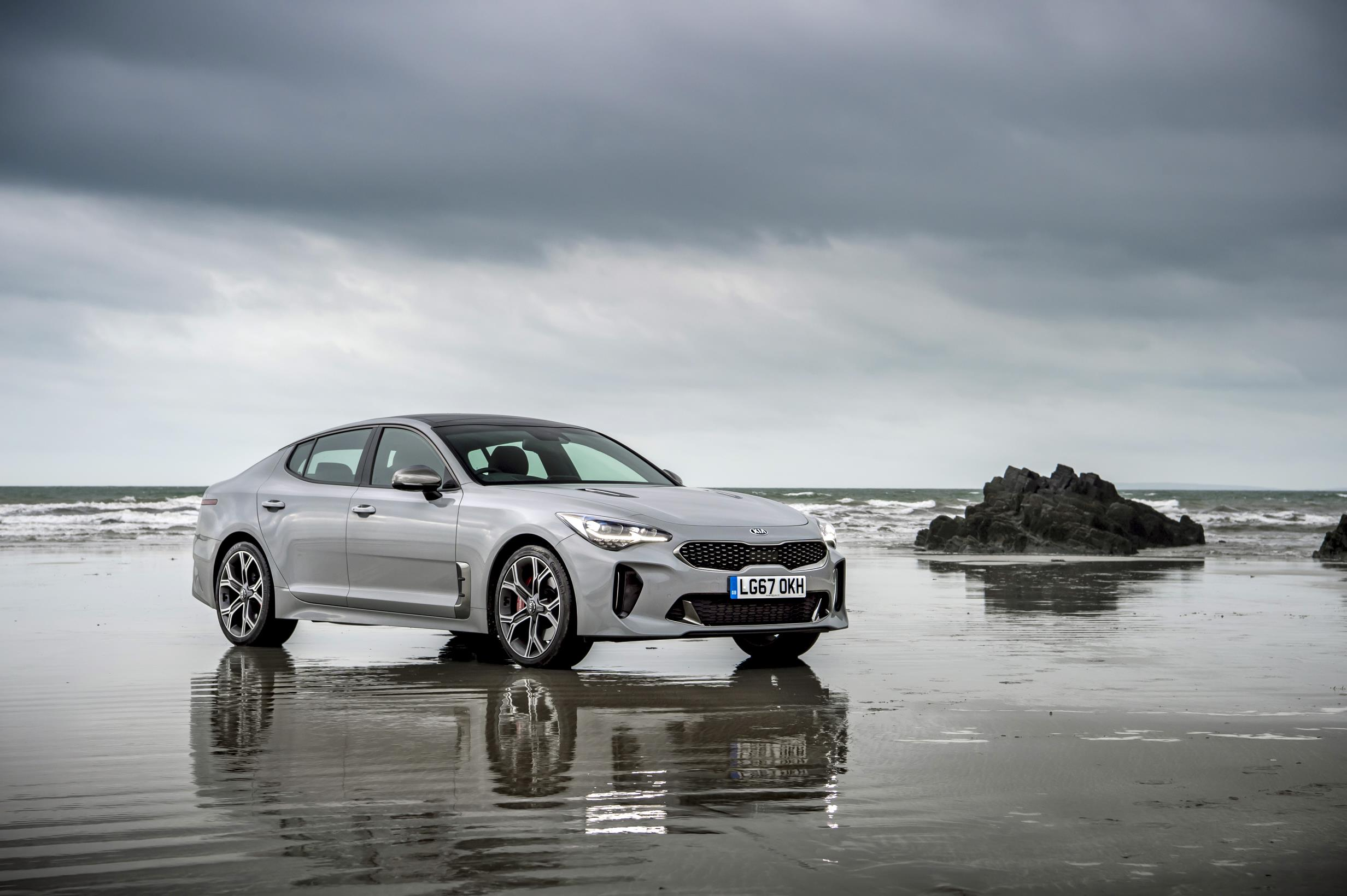Kia Stinger front view on beach