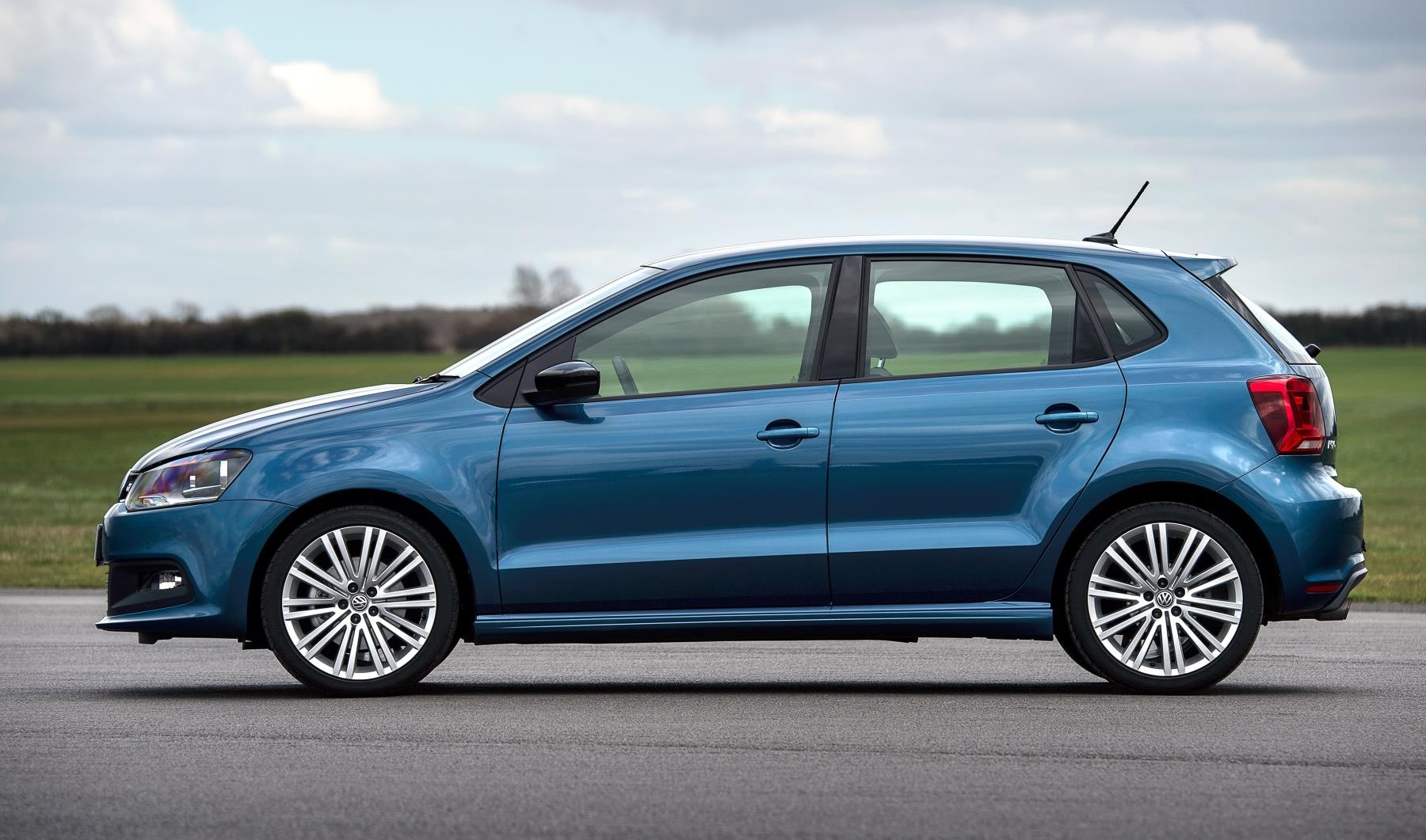 Volkswagen Polo side view in blue