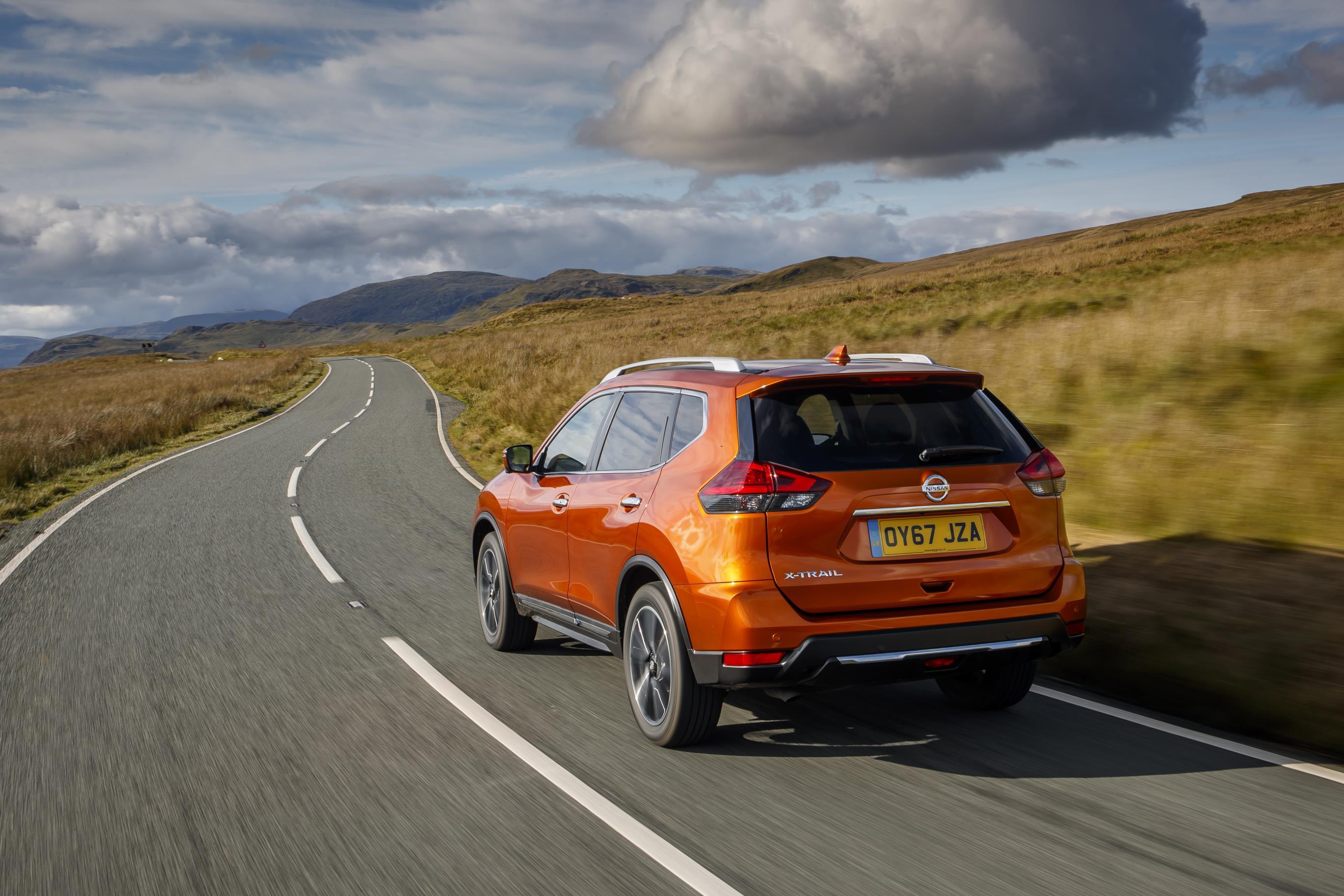 Nissan X Trail orange rear view