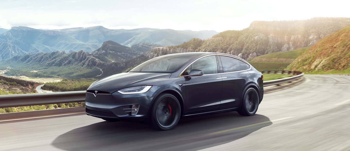 Tesla Model X on Twisting Road